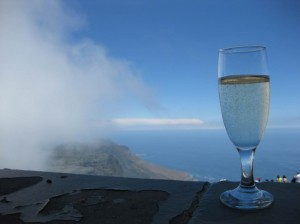 A glass of Simonsig Sparkling Wine perched atop Table Mountain