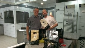 Franck Vidal & Chef Derek Poirier in kitchen at Valrhona's culinary school.