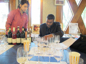 Ms. Misawa leading Joshua Kalinan through a tasting of Grace Winery wines.